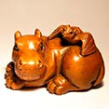 Wood Netsuke Bat on Hippo